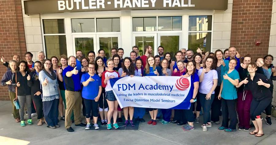 Physicians and physical therapists learning fast treatments for pain and stiffness using manual therapy with Fascial Distortion Model taught by FDM Academy
