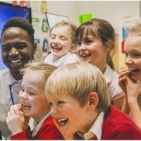 Group of school children laughing