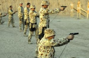 Members of Battle Group Reserve hone their skills on the 9mm Browning pistol at a range practice in southern Iraq. Credit: Defence