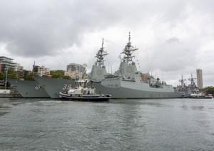 HMAS Hobart berths alongside her sister ship HMAS Brisbane at Fleet Base East. Defence