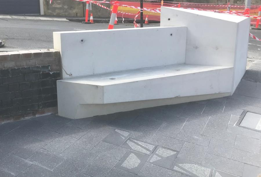 Custom seating and paving installed at the Pirie Street node