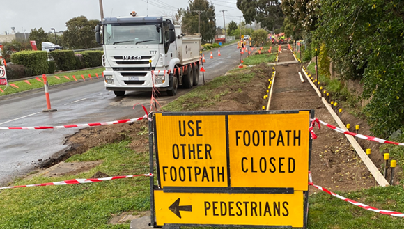 Footpath closed sign and roadworks