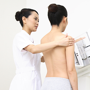 Clinician helping patient during mammography