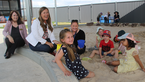 Mayor Cr Rhonda Sanderson and Member for Yan Yean Danielle Green in the sand pit Wallan East Family and Children's Centre.