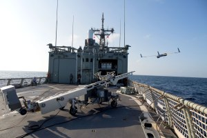 ScanEagle is launched from the flight deck of HMAS Newcastle in the Middle East region. Credit: Defence