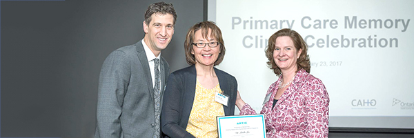 Dr. Linda Lee receives a plaque in honour of her work to create and spread Primary Care Memory Clinics