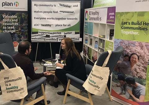 BCHC team member Johanna chatting with a local official at our UBCM tradeshow booth