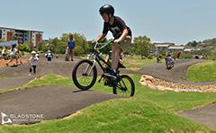 Boy on bike on pump track