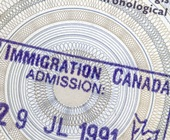 Immigration Canada stamp on paper