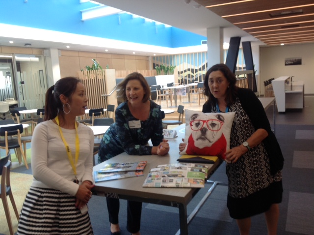Image of Candy Wu Zhang, Helen Wyn and Deborah Lam around a table in New premises in CHCH
