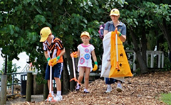 Photo of family participating in Clean Up Australia Day