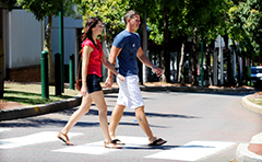 Woman and man crossing road