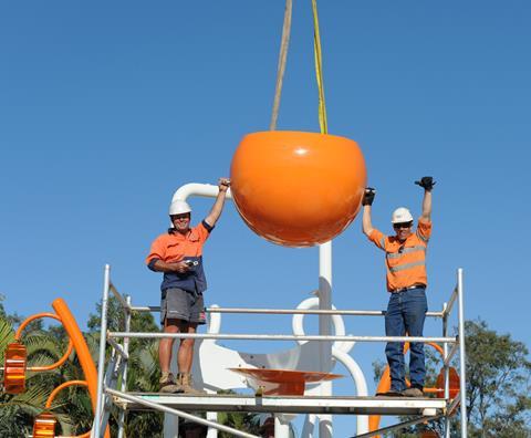 Workmen installing big bucket