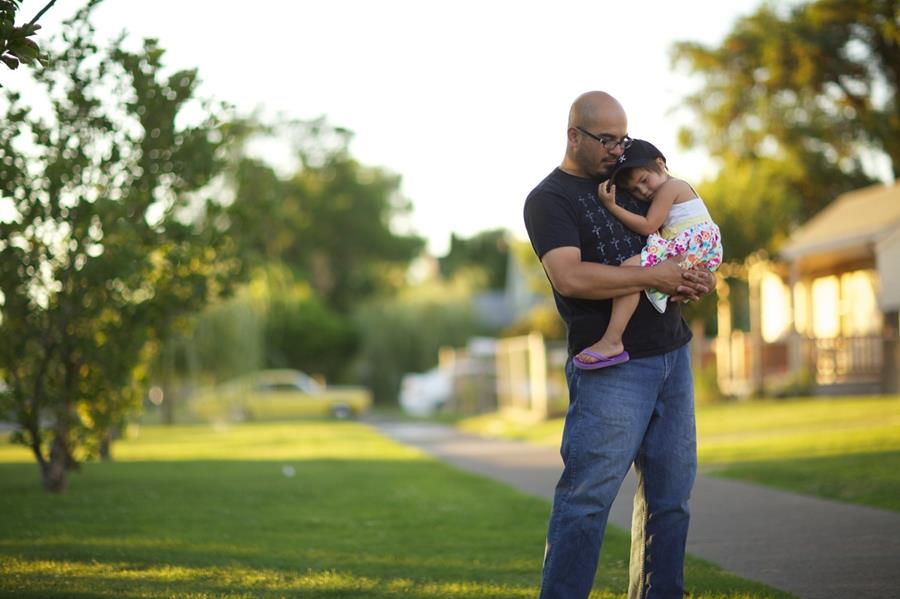 Father holding young daughter