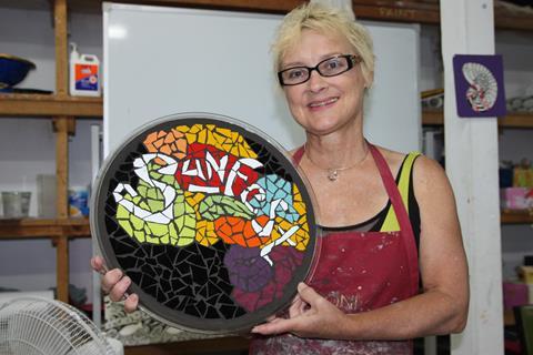 Woman holding mosaic platter