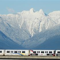 Skytrain and the Twin Sisters, image via The Province