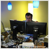 man working with dual screens