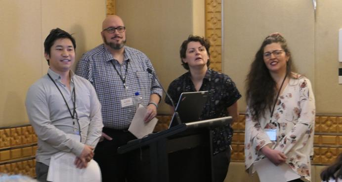 Four presenters at conference
