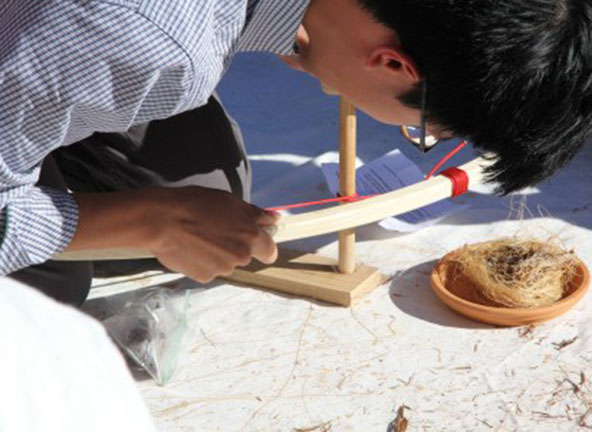 Image of student and fire making activity