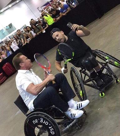Two men playing wheelchair tennis