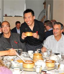 Bowen Zhang, OMNI Mandarin News Anchor, serves up dim sum with the best smile of the day