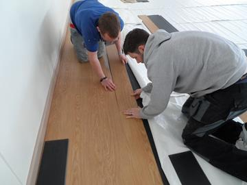 Laying the InstaLay flooring at White Rock Shool