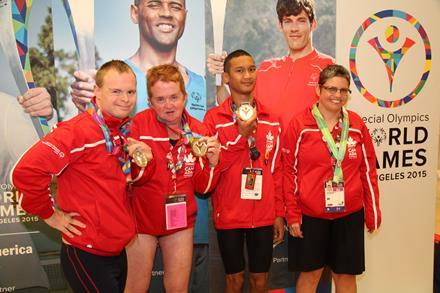 Special Olympics athletes Magnus Batara and teammates