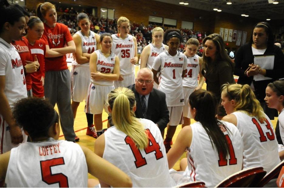 Marist women's basketball team huddled up on the sideline