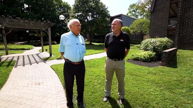 Bob from SUNDEK of Washington talks with Stevenson Village