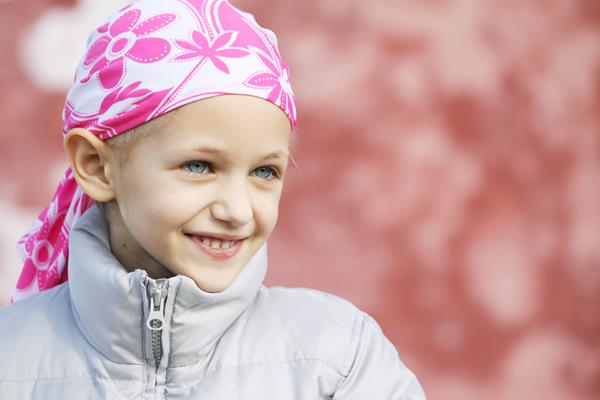 Smiling patient with headscarf