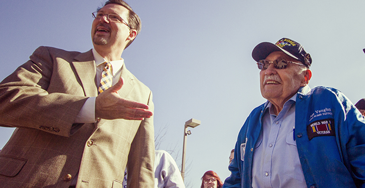 OSUIT President Bill R. Path speaks with Jim Vaughn during a past Veterans Day Celebration.