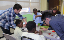 GW SPS students conduct outreach sessions in local middle schools.
