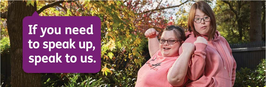 Image of two NDIS participants flexing their biceps in a jovial manner
