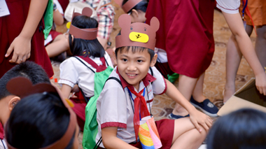 A child wears a bear hat ready for an interactive storytelling session