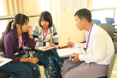 Myanmar Ministers and support staff work together in class