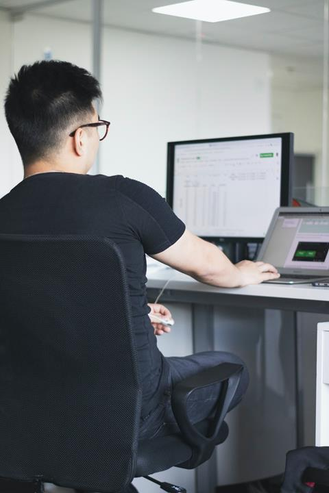 Man looking at a spreadsheet on computer