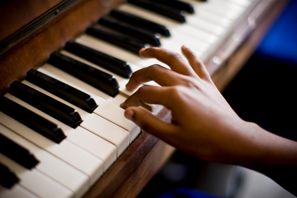 Fingers playing the piano.