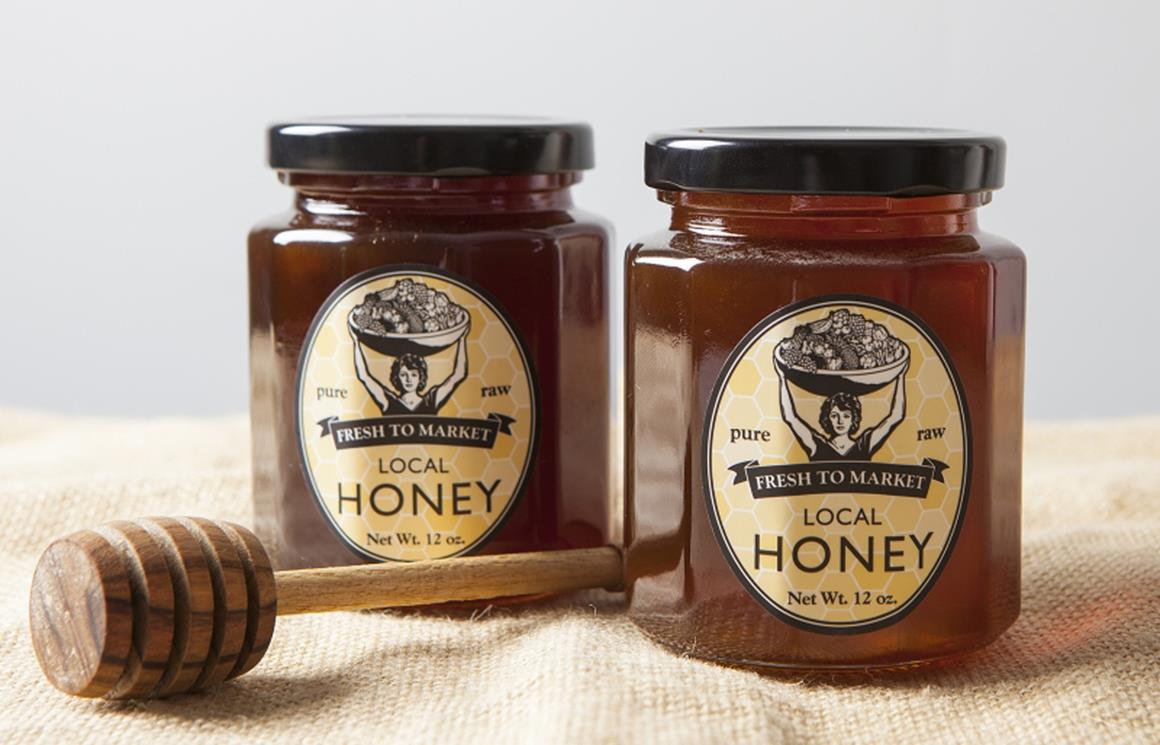 Two jars of Fresh to Market honey