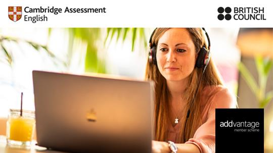 Addvantage banner showing a woman working on a macbook having her headsets on