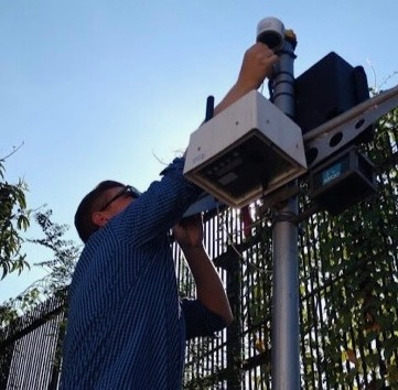 Dan Westervelt setting up a low-cost air quality monitor.