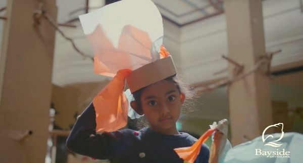 girl with paper hat