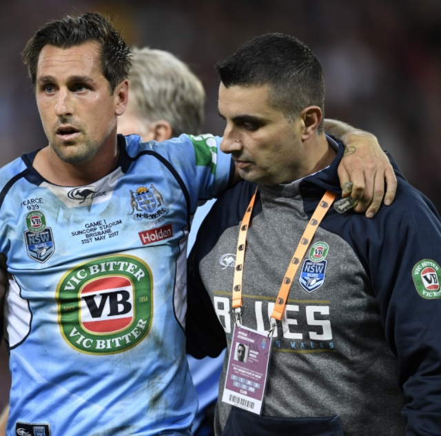 Dr. Moses helps NRL player Mitchell Pearce during a State of Origin match