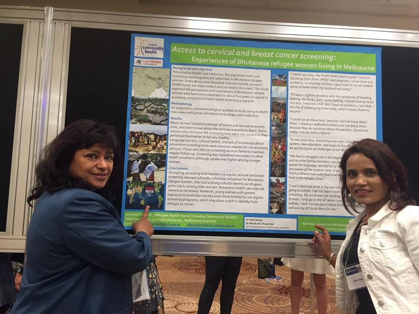 Photo: Jamuna Parajuli, Refugee Health Nurse showing her poster to Anna Banerji, Course Director of North American Refugee Health Conference