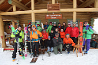 Group of skiers out front of Assiniboine Lodge