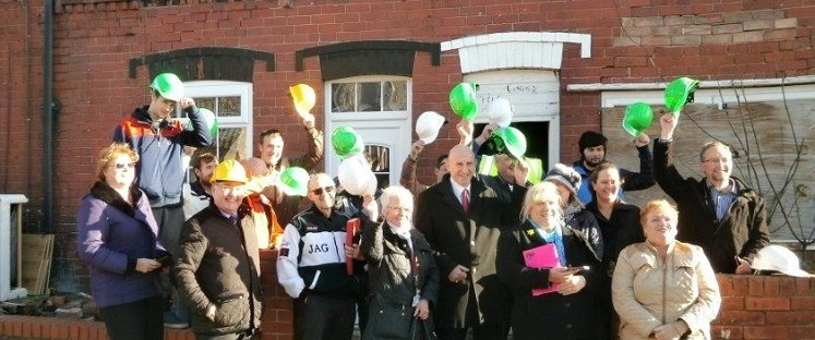 Residents celebrate purchasing empty homes for refurbishment
