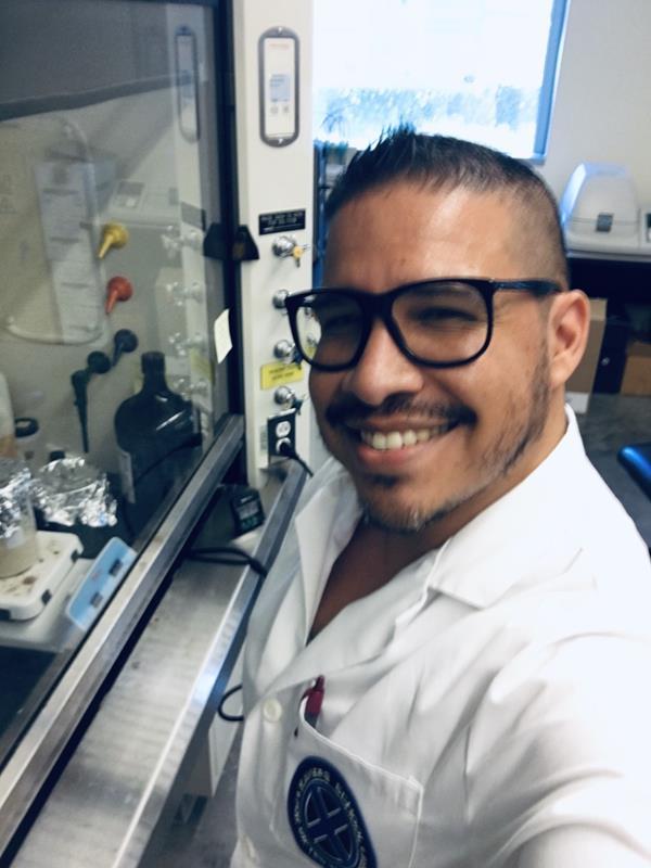 Male student in Lab Coat