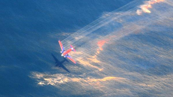 An aircraft releases dispersant over oil spilled from the Deepwater Horizon, off the shore of Louisiana, May 5, 2010. Photo: U.S. Coast Guard/Stephen Lehmann