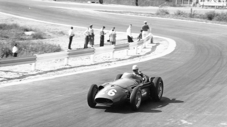 Woman driving old racing car on track