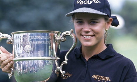 Annika Sörenstam holding trophy and smiling